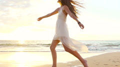 Stock Video Footage of Happy Girl Having Fun at the Beach on Luxury Island at Sunset. Slow Motion