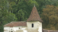 Tower and roof of an old building in Brasov Stock Footage