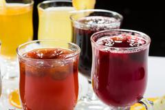 Stock Photo of mulled wine. fruit or berry drink. alcohol winter. against a dark background