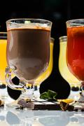 mulled wine. fruit or berry drink. alcohol winter. against a dark background - stock photo