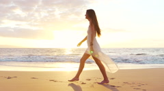 Happy Girl Having Fun at the Beach on Luxury Island at Sunset. Slow Motion - stock footage