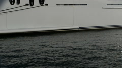 The vertical panning of modern yacht with helicopter Stock Footage