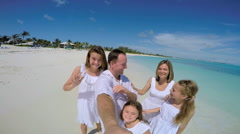 Caucasian family in white clothes filming video selfie on the beach Stock Footage