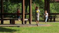 Toddlers with his older brother at the site for a picnic - stock footage
