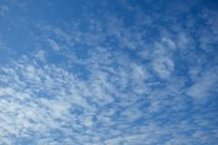 Blue sky and easy white clouds Stock Photos