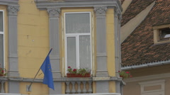 Stock Video Footage of European Union flag and a window with a flower pot, Brasov