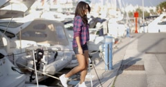 Stock Video Footage of Woman Goes Ashore From A Boat