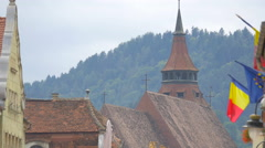 Waving flags on a building near the Black Church, Brasov - stock footage