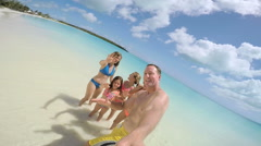 Selfie portrait Caucasian family enjoying tropical vacation beach Stock Footage