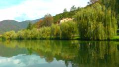 Countryside lake video, with mountains and countryside house. Peaceful and high  - stock footage