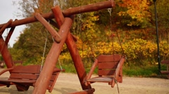 Wooden swing at the playground Stock Footage