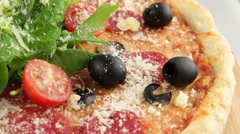 Whole salami pizza with cherry tomatoes - stock footage