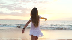 Stock Video Footage of Happy Girl Having Fun at the Beach on Luxury Island at Sunset. Model Girl Spi