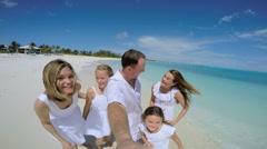 Social media portrait of happy Caucasian family on beach vacation Stock Footage