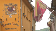 Gaura Dulce restaurant sign and emblem on Johann Gott street, Brasov Stock Footage