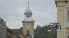 The clock tower of the St Peter and Paul Cathedral in Brasov Stock Footage