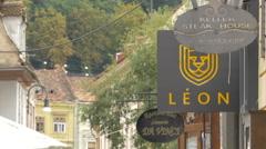Restaurant signs on Apollonia Hirscher street in Brasov Stock Footage