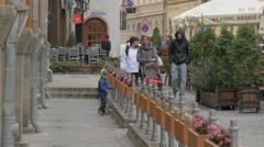 Family walking on Apollonia Hirscher street in Brasov Stock Footage