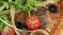 Pizza with grilled veal and parmesan cheese - stock footage