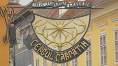 View of Carpathian Stag restaurant sign in the Council Square in Brasov Stock Footage