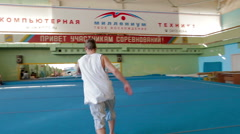IZHEVSK, RUSSIA - MART 2014:  gymnast practicing his skills at the gym Stock Footage