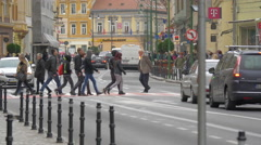 People crossing the Muresenilor street, Brasov Stock Footage