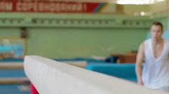 Gymnast practicing on balance beam Slow motion Stock Footage