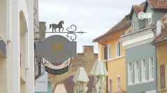 Casa Rozelor gasthouse sign on Michael Weiss street, Brasov Stock Footage