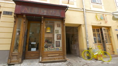 Antichita- an antique shop on Apollonia Hirscher street in Brasov Stock Footage