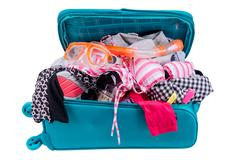 Packing to go on vacation isolated on white background Stock Photos