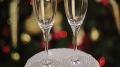 Empty glasses of champagne on the background of the Christmas tree Stock Footage