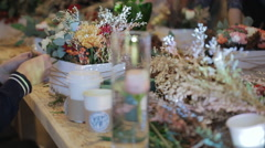 Stock Video Footage of florist adds details in a pot of flowers, individual design project