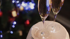 Two glasses of champagne ready for christmas celebration, on red background Stock Footage