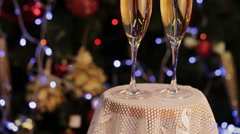 Champagne in two glasses  the christmas background - stock footage
