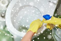 Close up of hand with detergent cleaning toilet Stock Photos