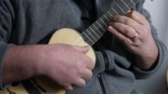Man playing Portuguese ukulele cavaquinho , slider shot Stock Footage