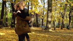 Couple cuddling and having fun in the park, steadycam shot, slow motion shot at  - stock footage