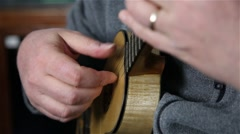 Man playing Portuguese ukulele Arkistovideo