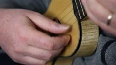 """Man playing Portuguese ukulele, """"cavaquinho"""" Stock Footage"""