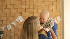 Stock Video Footage of mother and baby playing and smiling in studio