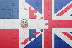 puzzle with the national flag of great britain and dominican republic - stock photo