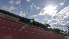 Stadium Running Track Sunlight Lens Flare Sky Clouds Time Lapse - stock footage