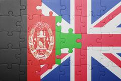 puzzle with the national flag of great britain and  afghanistan - stock photo