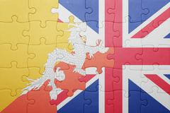 puzzle with the national flag of great britain and bhutan - stock photo