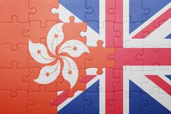 puzzle with the national flag of great britain and hong kong - stock photo