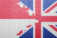 Puzzle with the national flag of great britain and indonesia Stock Photos