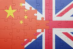 puzzle with the national flag of great britain and china - stock photo