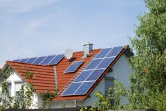 Green energy - House roor with solar panels Stock Photos