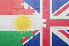 puzzle with the national flag of great britain and kurdistan - stock photo