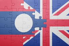 Puzzle with the national flag of great britain and  laos Stock Photos